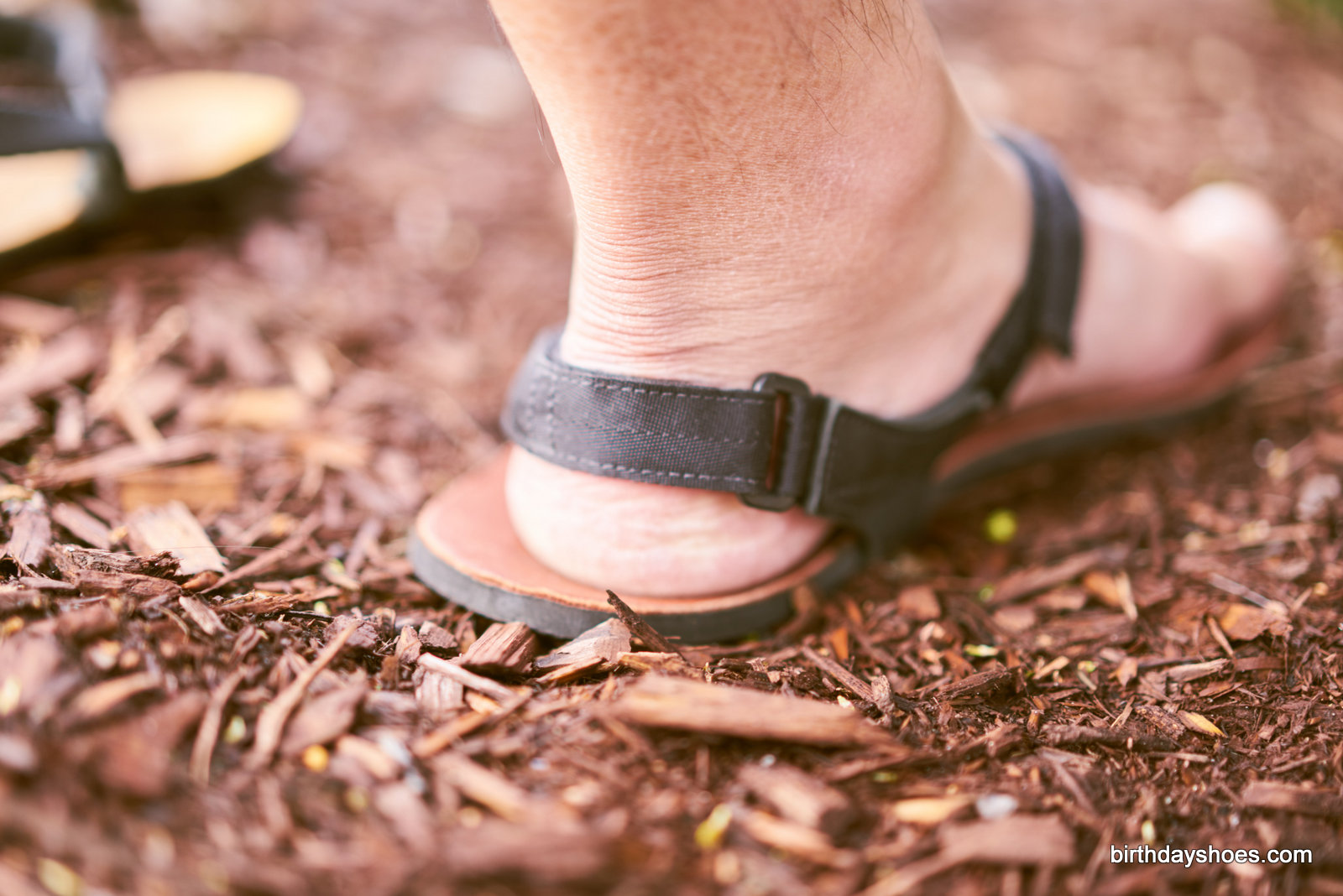 The new heel strap features a velcro adjustment for unparalleled, customized security when running or hiking