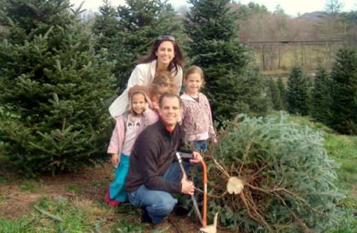 Alan and family pause for a shot next to their tree!