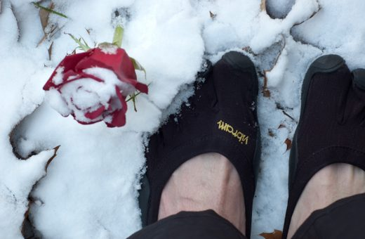 Enjoying a bit of snow between the toes in his Classics, Andrew snaps a shot of a rose.