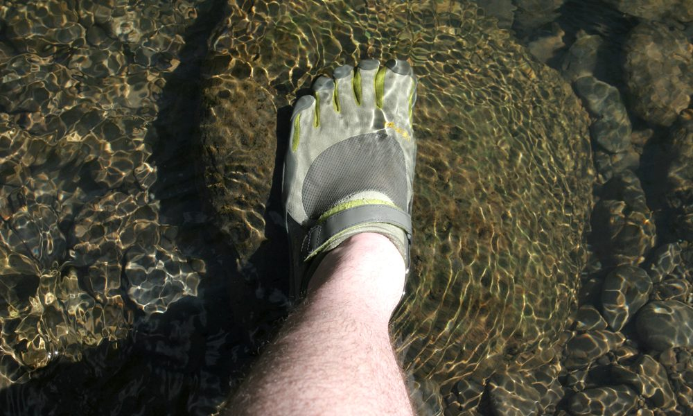 Mountain streams pose no problems for KSO-clad feet. Ryan bounds into a stream in Maui!