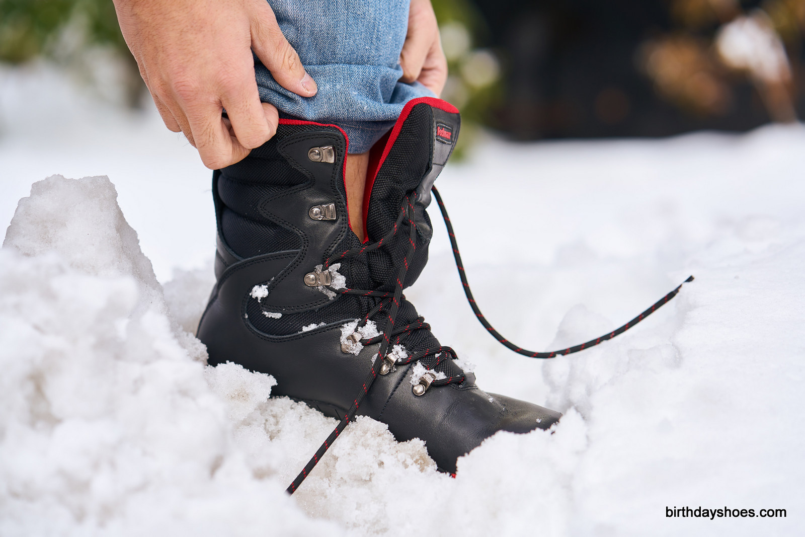 The high-slung tongue starts about 2/3 of the way up the boot; higher than a standard boot for added protection from puddles and snowbanks