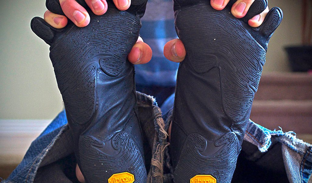 Trevor demonstrates the flexibility he gets in his Moc Vibram Five Fingers by putting his fingers between the toes!  This photo provides a nice look at the underside of the kangaroo leather Moc VFF, too!