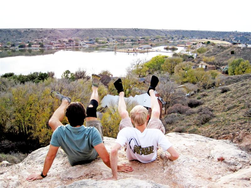 Having conquered the canyon, Josh and Barret raise their VFF-shod feet into the air!