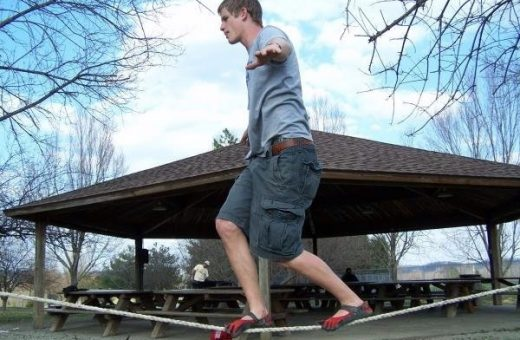 Vibram Five Fingers fan Morgan demonstrates slacklining in his red and black Sprint Vibrams.  Keep that balance!