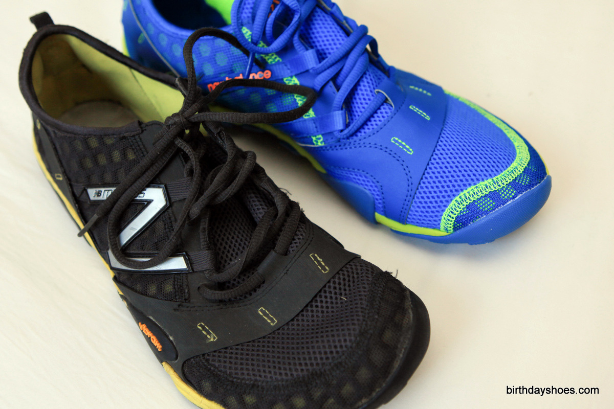 The original Minimus 10 Trail in black on the left compared to the updated New Balance Minimus 10v2 Trail on the right.